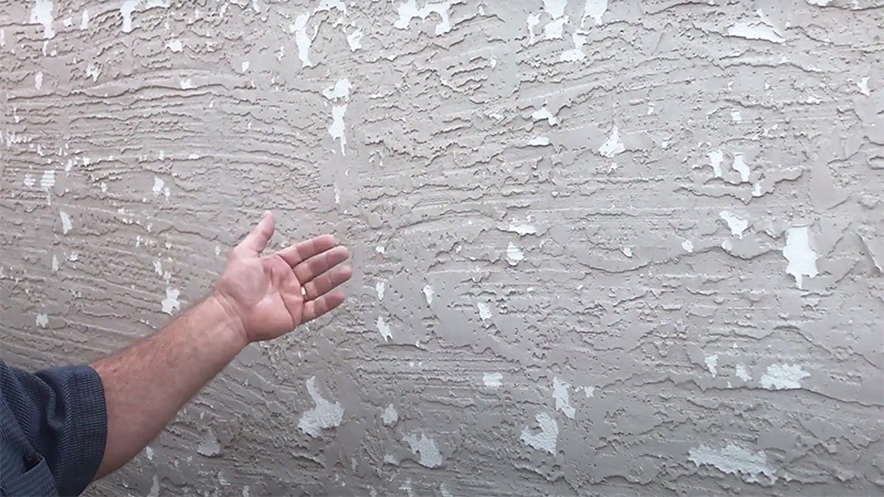 Paint is peeling on Stucco