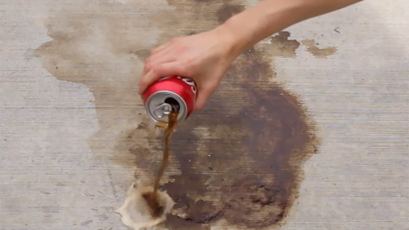 How to remove oil stains from concrete with Coca Cola