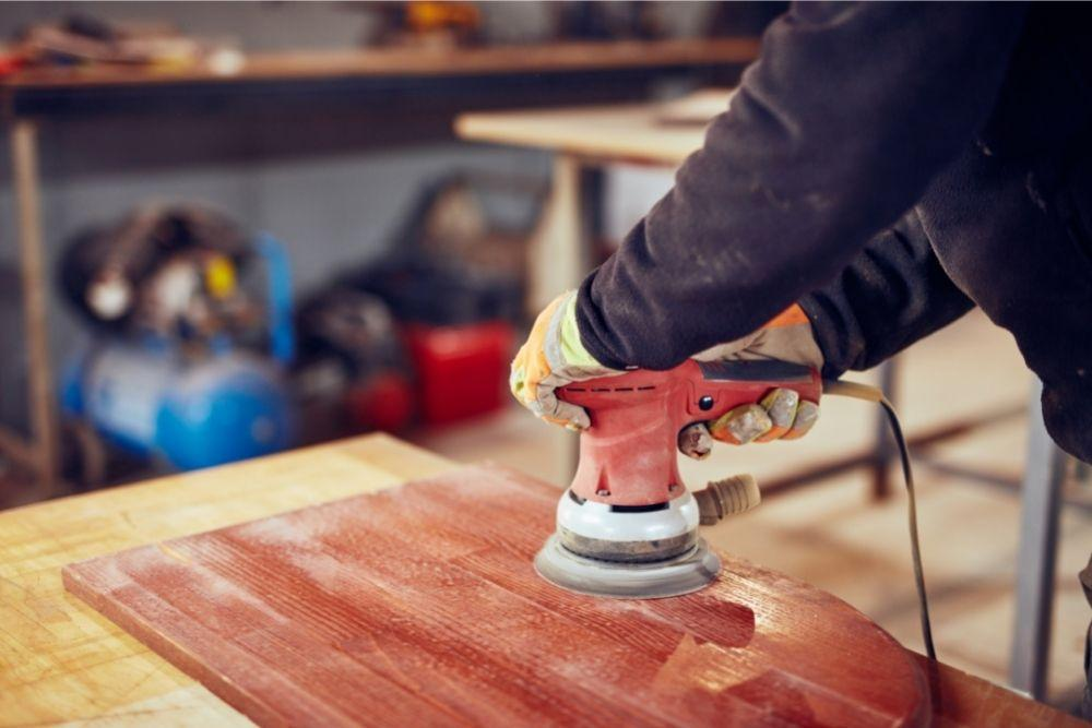 Can I use an orbital sander to remove paint